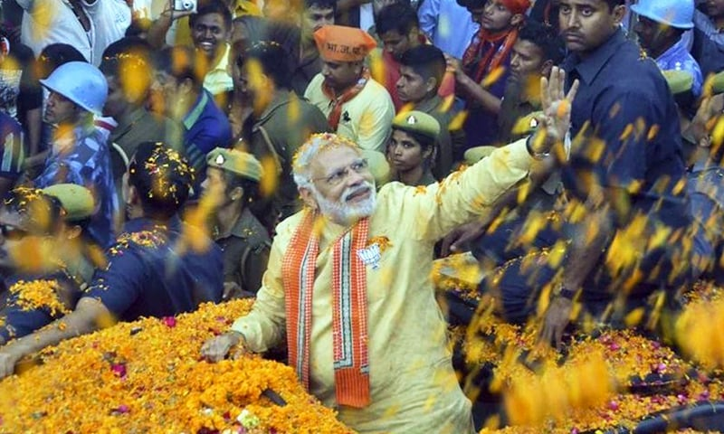 Prime Minister Narendra Modi waves to people during a road show in Varanasi. — Photo: Adarsh Gupta/HT Photo/File