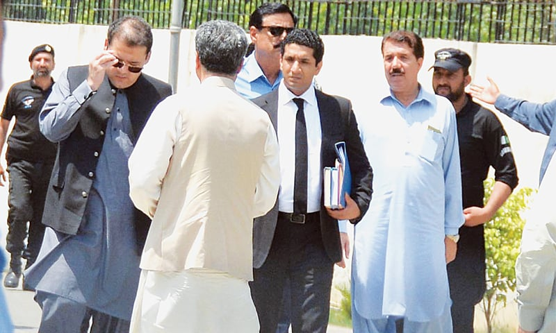ISLAMABAD: Hussain Nawaz, the prime minister's son, leaves after the joint investigation team's proceedings in the Panama Papers case on Sunday.—INP