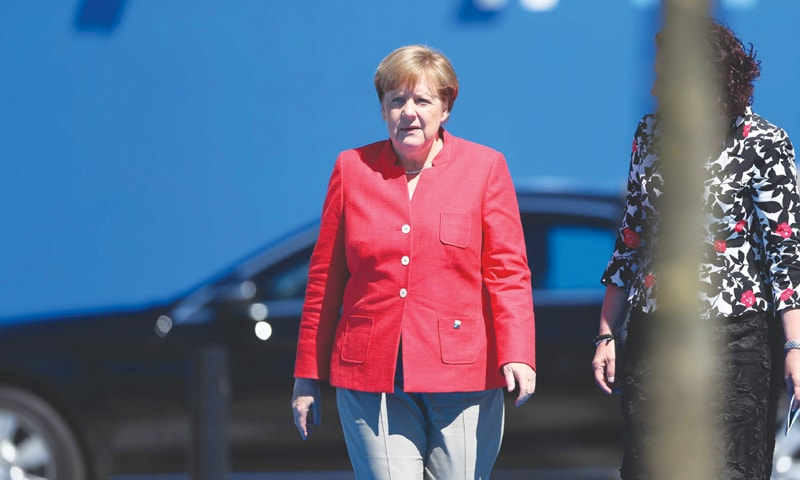 """After contentious meetings with President Donald Trump last week, German Chancellor Angela Merkel, seen here on Thursday arriving for Nato meetings, declared a new chapter in US-European relations, saying that Europe """"really must take our fate into our own hands"""".—Bloomberg"""