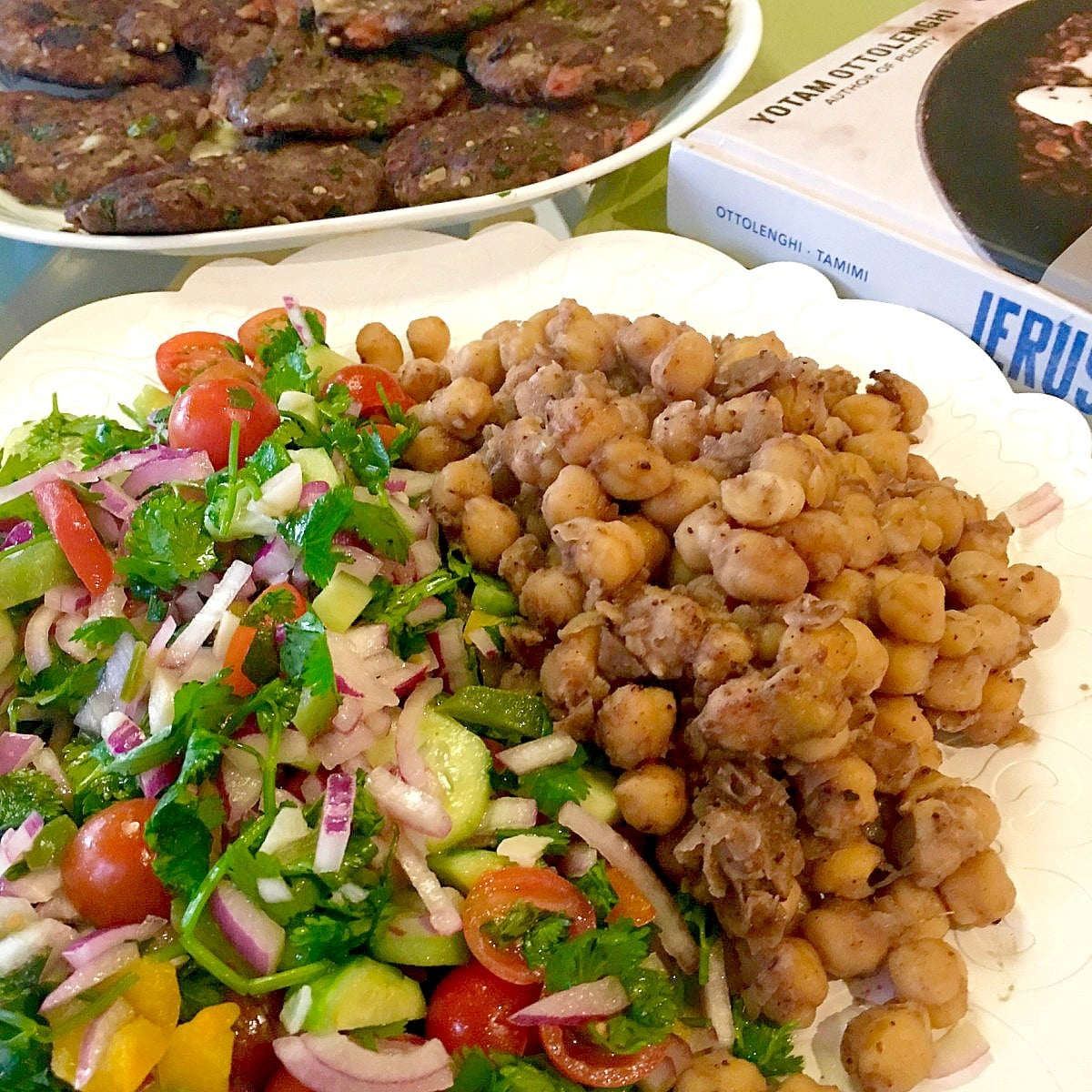 The combination of cold and fresh salad with the warm chickpeas is surprisingly enticing, says Sami Tamimi and Yotam Ottolenghi's cookbook Jerusalem