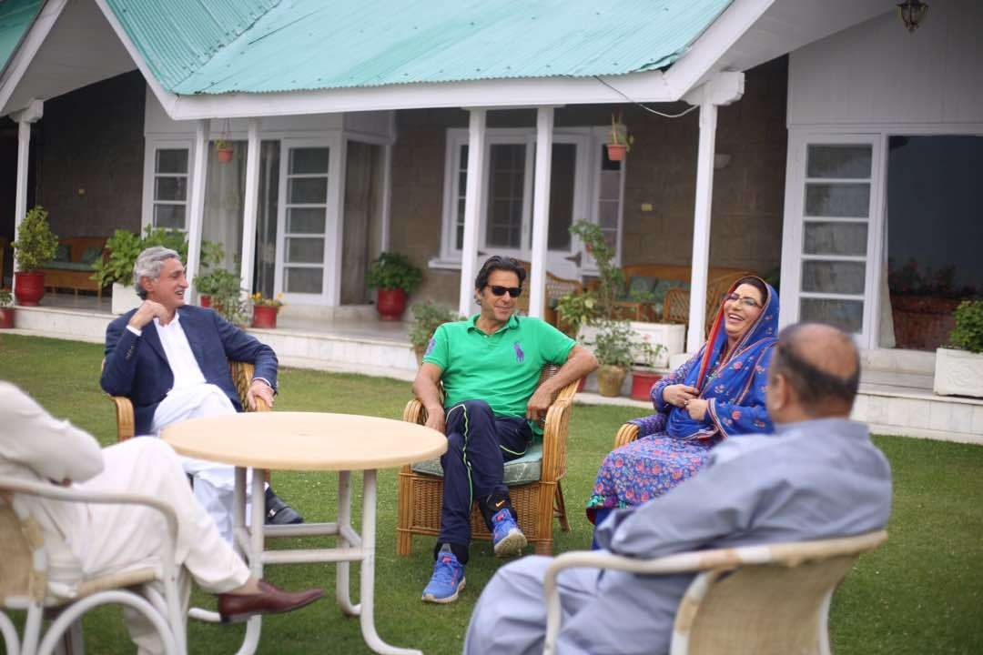 Awan (second from right) is seen meeting with PTI chief Imran Khan and General Secretary Jahangir Tareen on Tuesday.Photo: PTI's Twitter account