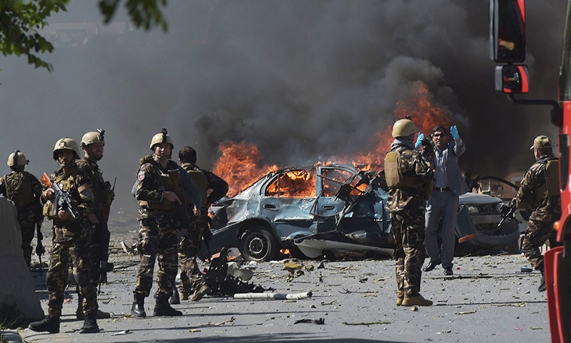 Afghan security forces personnel are seen at the site of the car bomb attack.— AFP