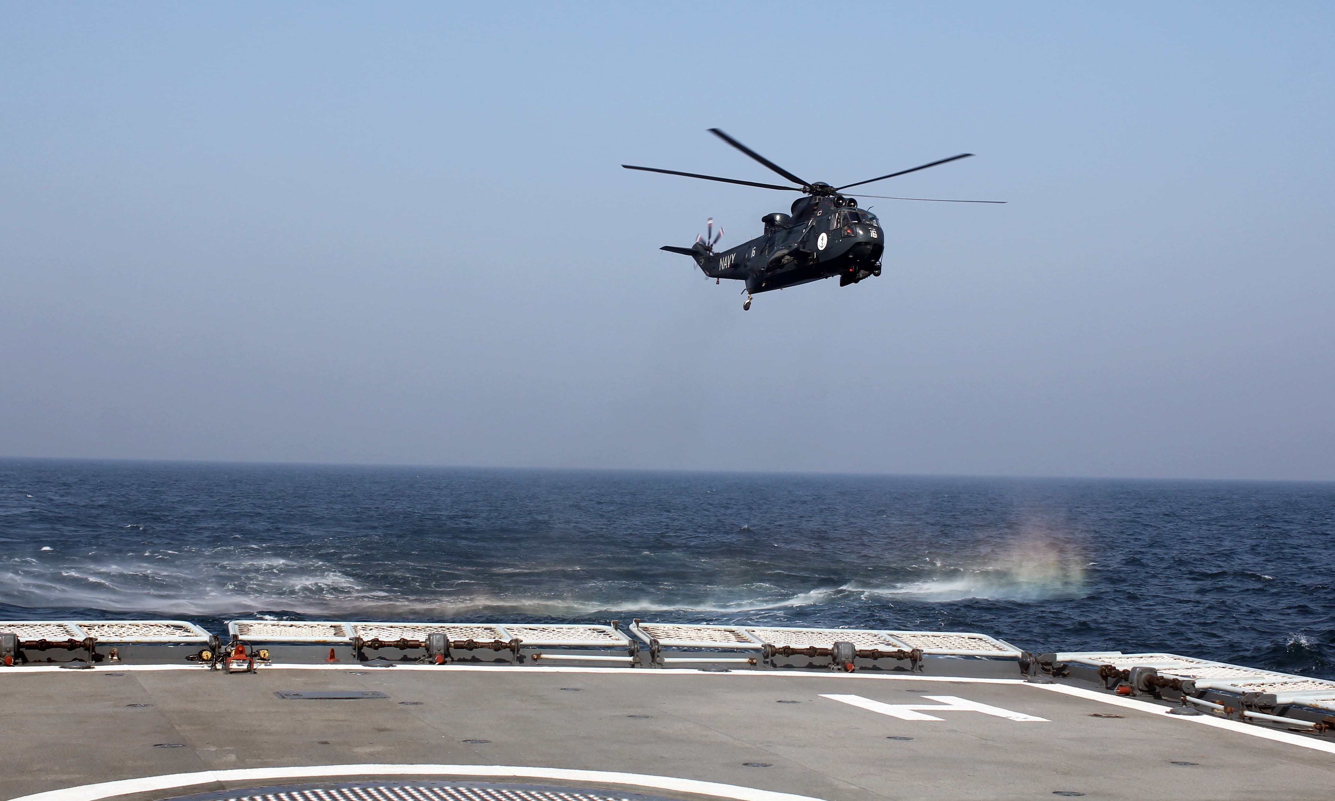 A Sea King helicopter is seen approaching a naval ship in the Arabian Sea. — Tauseef Mallick/File