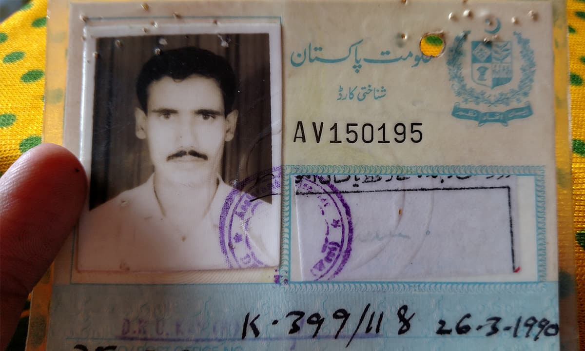 Ghulam Hussain shows his father's old National Identity Card | Bilal Karim Mughal