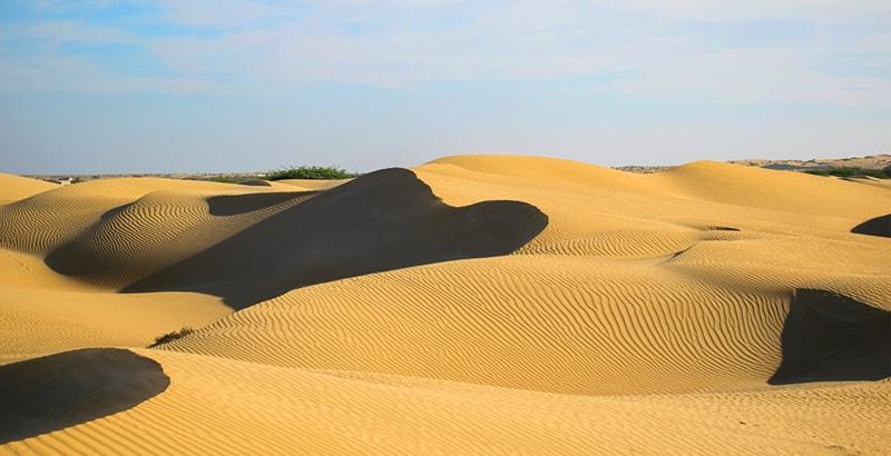 Stunning sand dunes from the sea at Pishukan