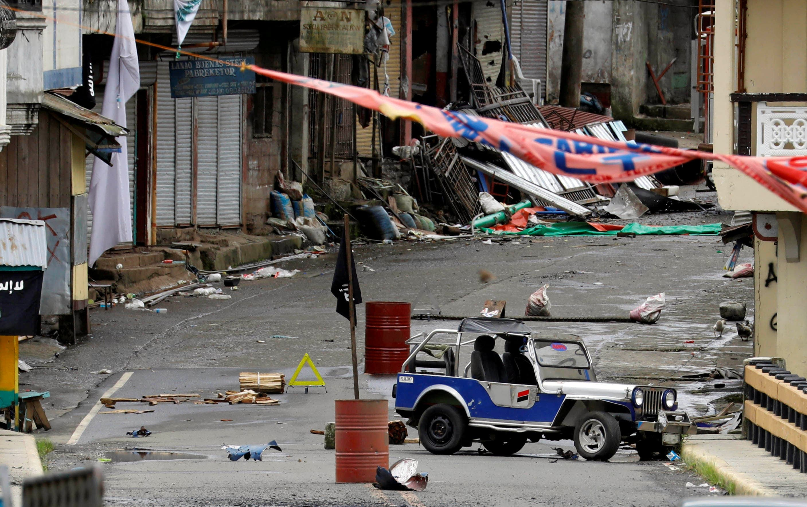 A view of the Maute group stronghold with an IS flag in Marawi, May 29.— Reuters