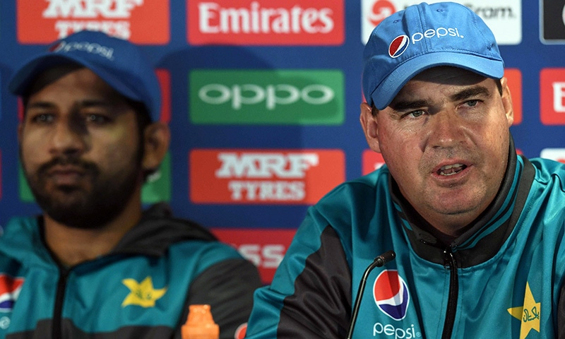 Pakistan coach Mickey Arthur (R) and captain Sarfraz Ahmed attend a press conference at Edgbaston cricket ground.— AFP