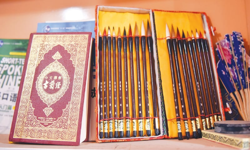 A copy of the Quran in Chinese with writing implements. — Photo by Shazia Hasan