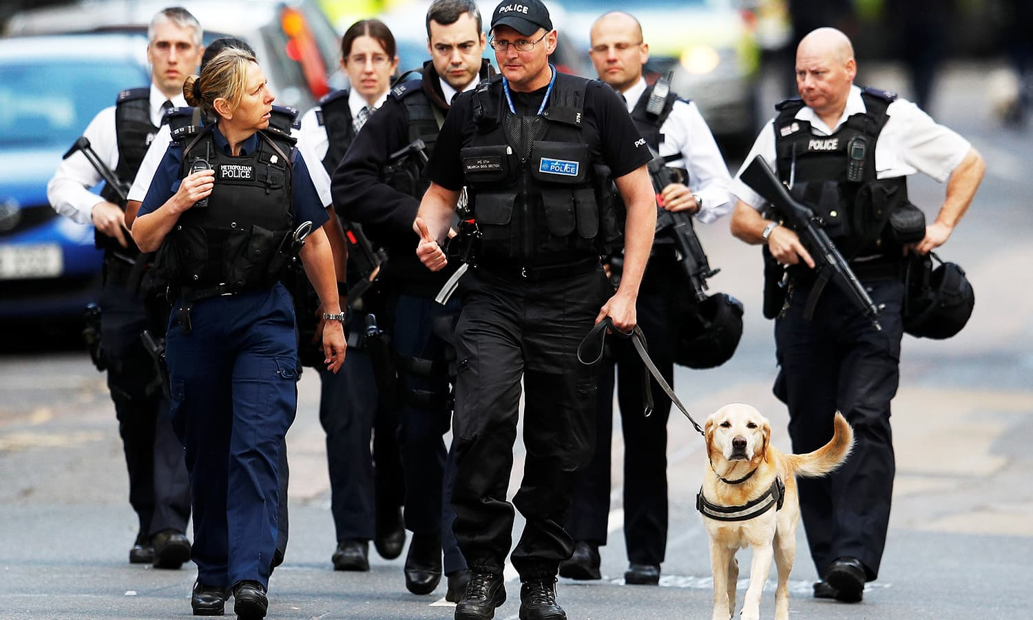 Armed police officers walk outside Borough Market after an attack left 6 people dead and dozens injured in London.─Reuters