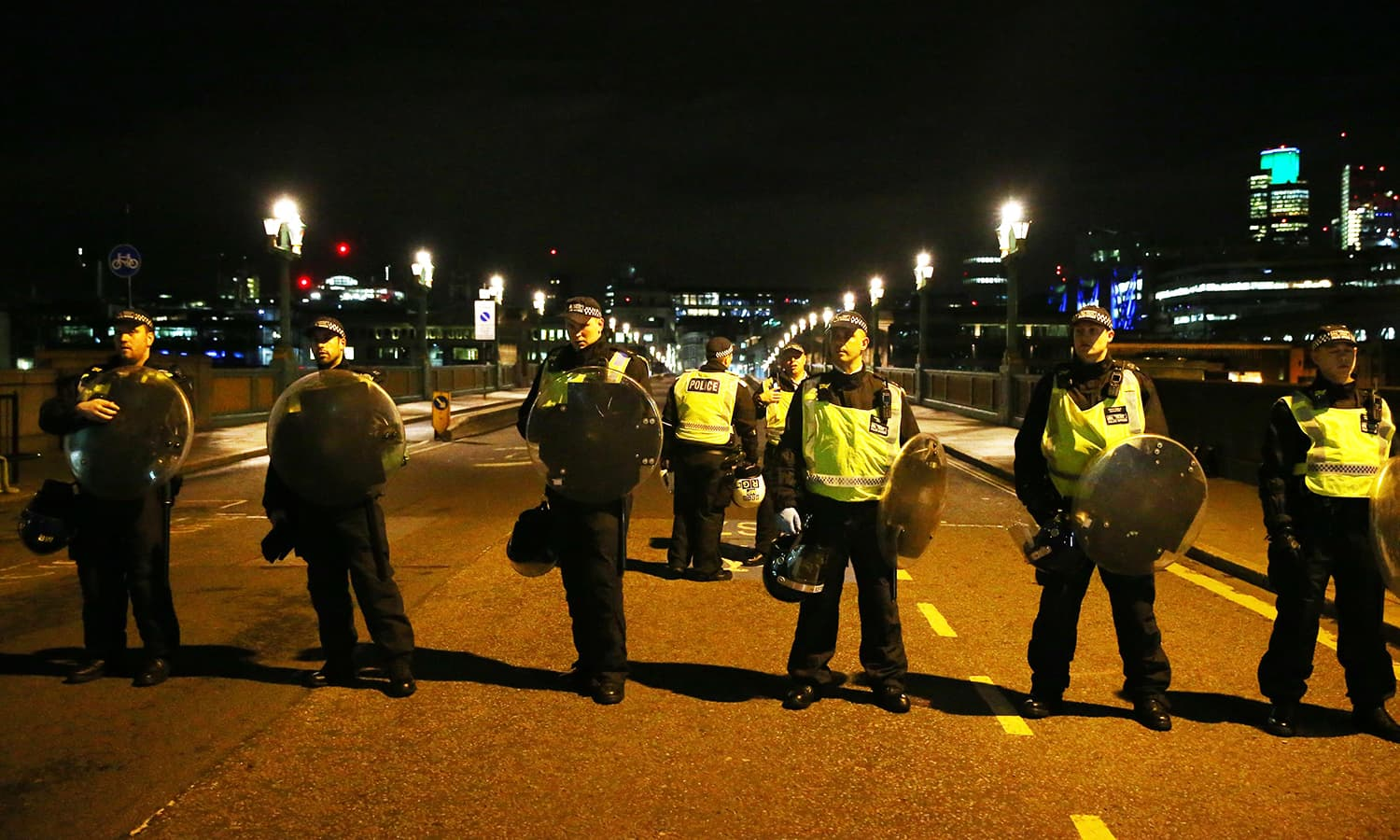 Police officers guard the approach to Southwark Bridge after an incident near London Bridge in London.─Reuters