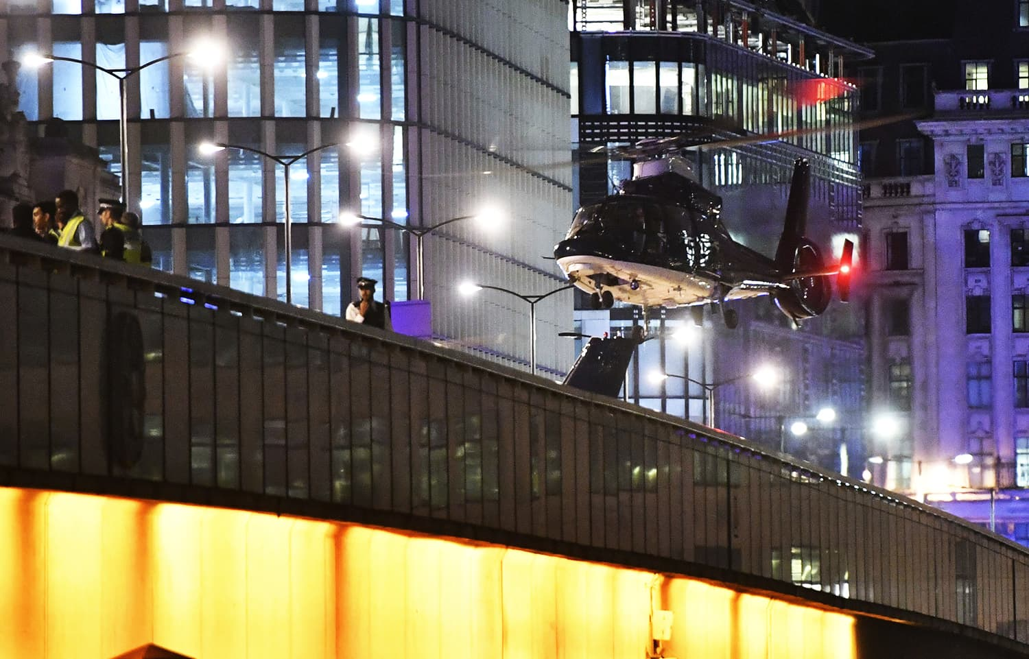 An helicopter lands on London Bridge after an attack in central London.─AP