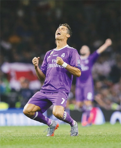 MAN-of-the-match Cristiano Ronaldo rejoices after scoring two goals on Saturday.—AP
