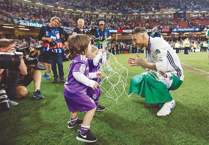 REAL Madrid captain Sergio Ramos celebrates with his children at the end of the final.—AP
