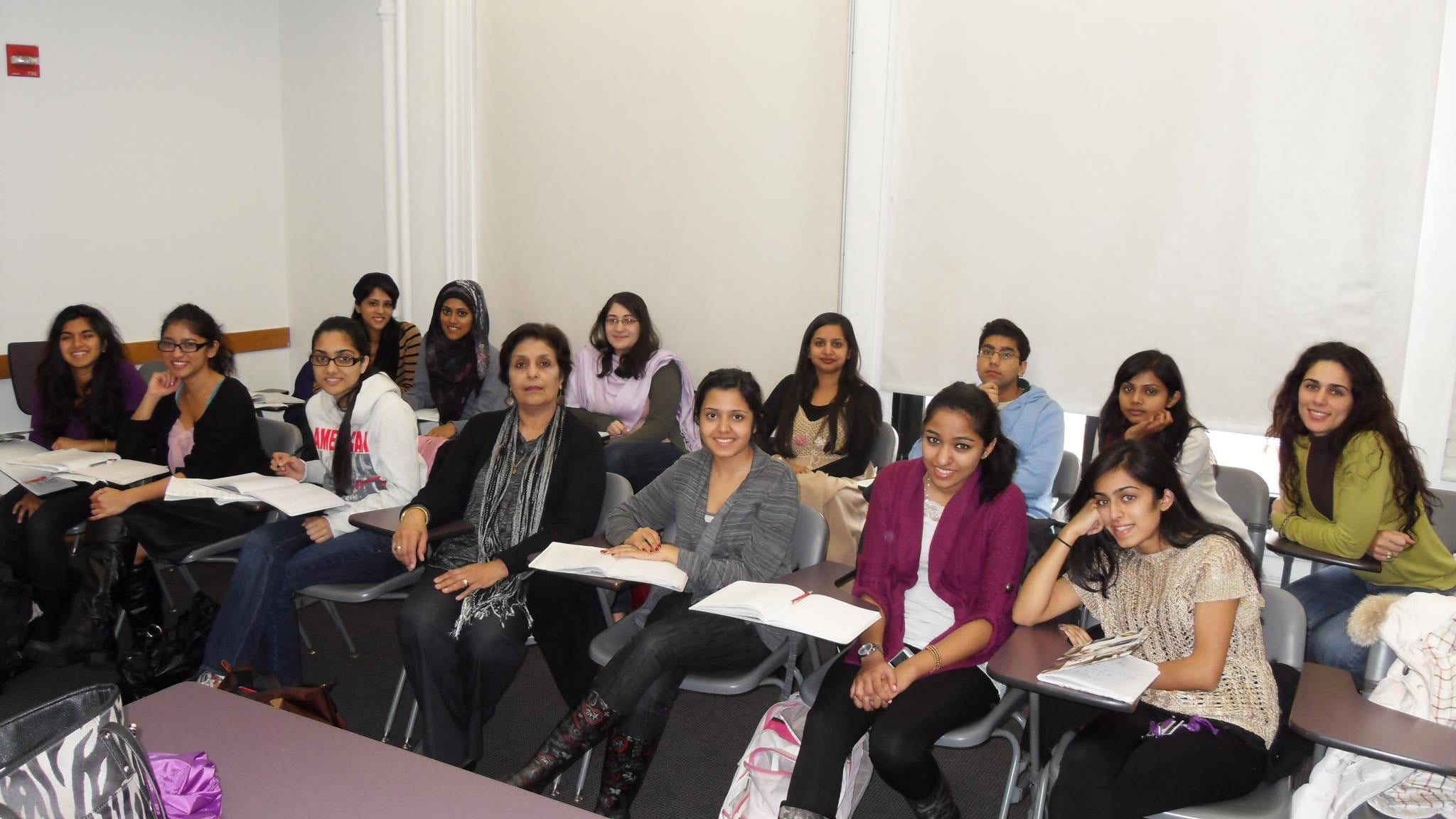 Professor Naqvi with her students.—Photo courtesy Tahira Naqvi