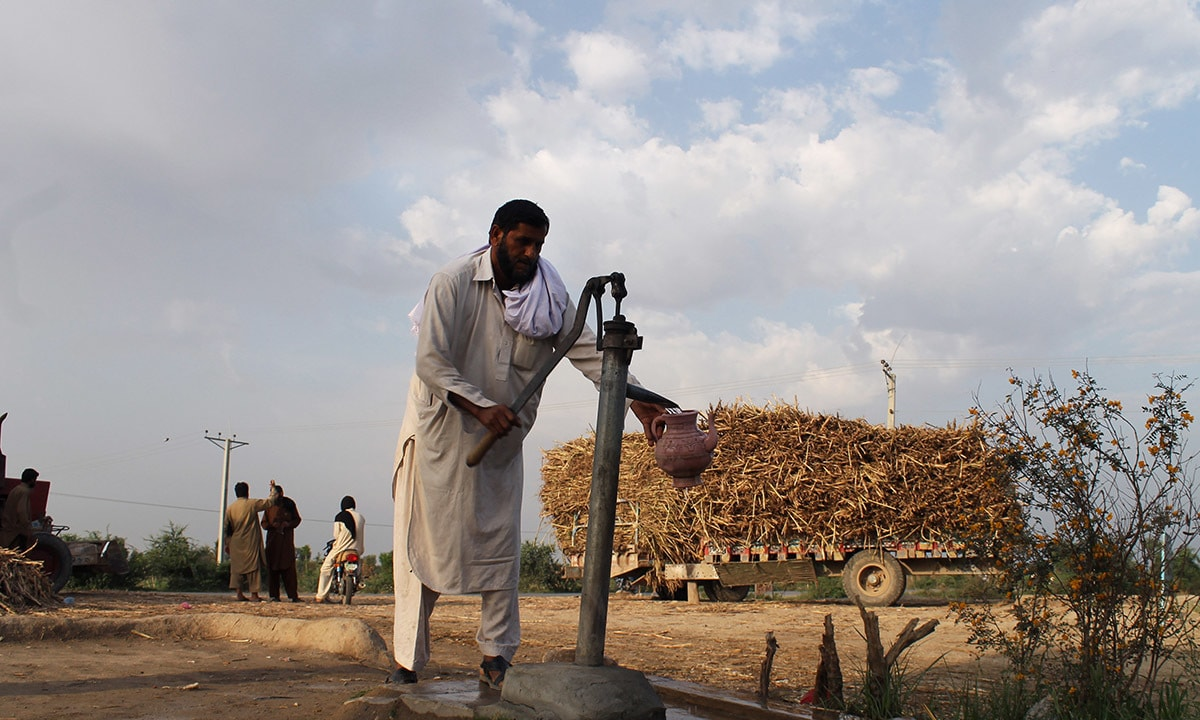 A man obtains water from a hand pump on the outskirts of Dera Ismail Khan | Photographs by Ghulam Dastageer