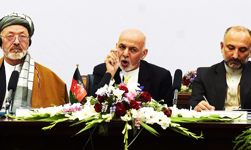 Afghan President Ashraf Ghani delivers his speech at an international peace conference.—AFP