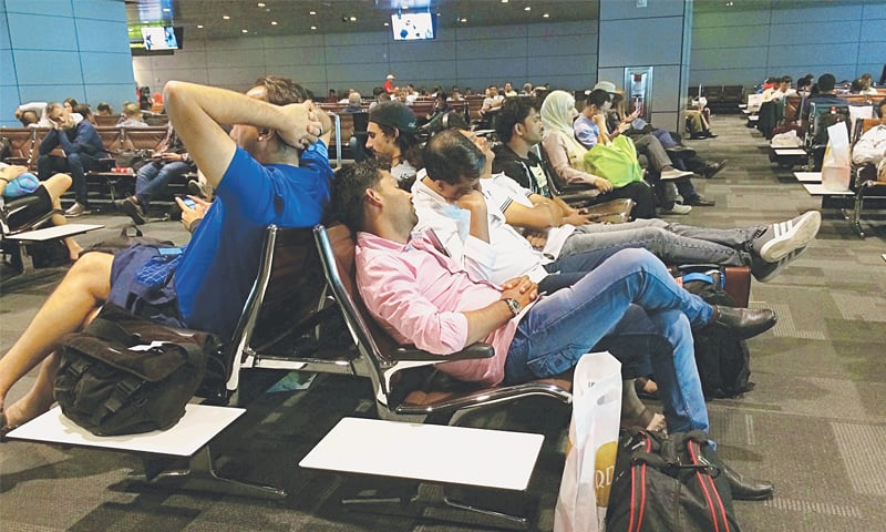 DOHA: Stranded passengers pictured at the Hamad International Airport on Tuesday after cancellation of their flights.—AP