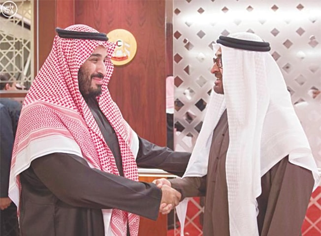 SAUDI deputy crown prince Mohammed bin Salman (left) shakes hands with Crown Prince of Abu Dhabi Sheikh Mohamed bin Zayed.