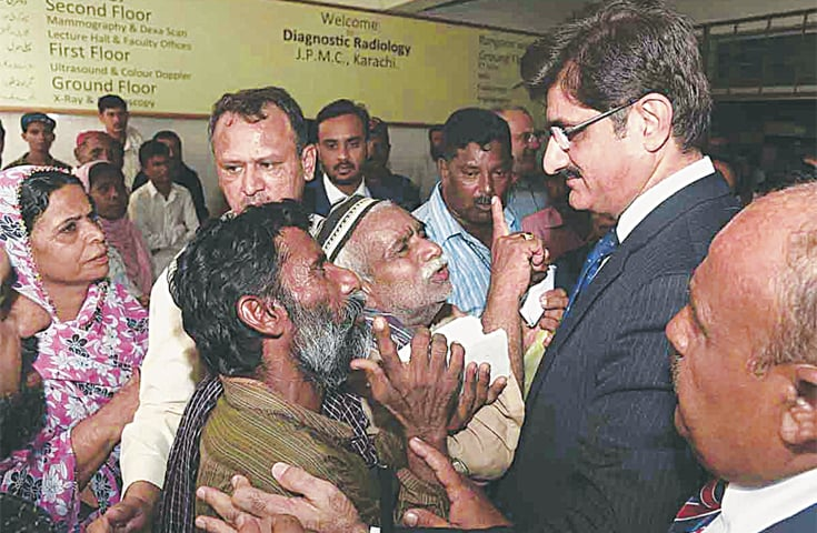 patients complaining to CM Murad Ali Shah about their problems at the JPMC on Wednesday.—APP