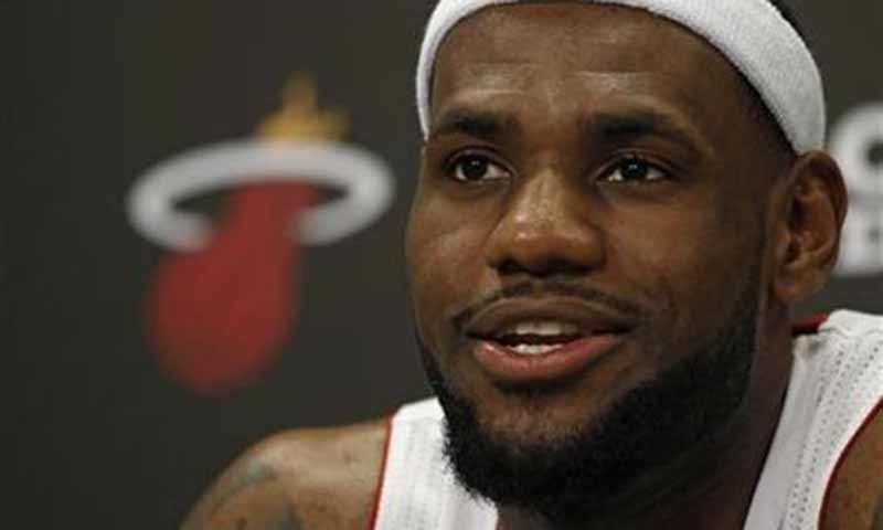 LeBron James answers questions during news conference. ─ Reuters