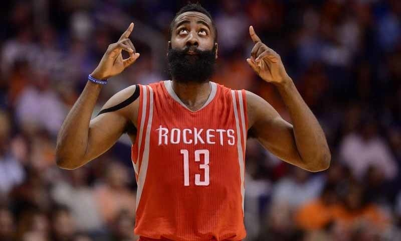 Harden (13) points to the sky against the Phoenix Suns at US Airways Center in 2015. ─ Reuters
