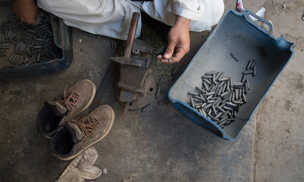 A man makes bullets in Dara Adam Khel