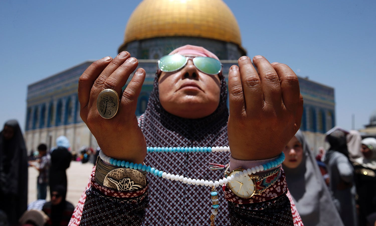 A Palestinian worshipper attends the second Friday prayers of Ramazan in front of the Dome of the Rock at Jerusalem's al-Aqsa mosque compound on June 9.— AFP