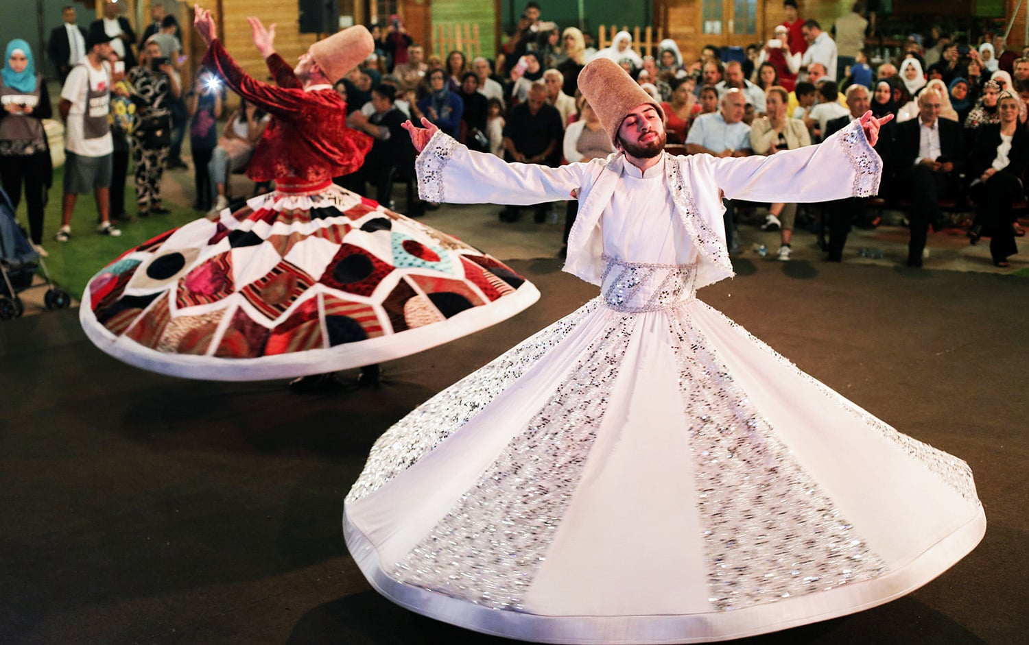 Lebanese whirling dervishes perform in a celebration during Ramazan in the capital Beirut's Verdun street on June 9.— AFP