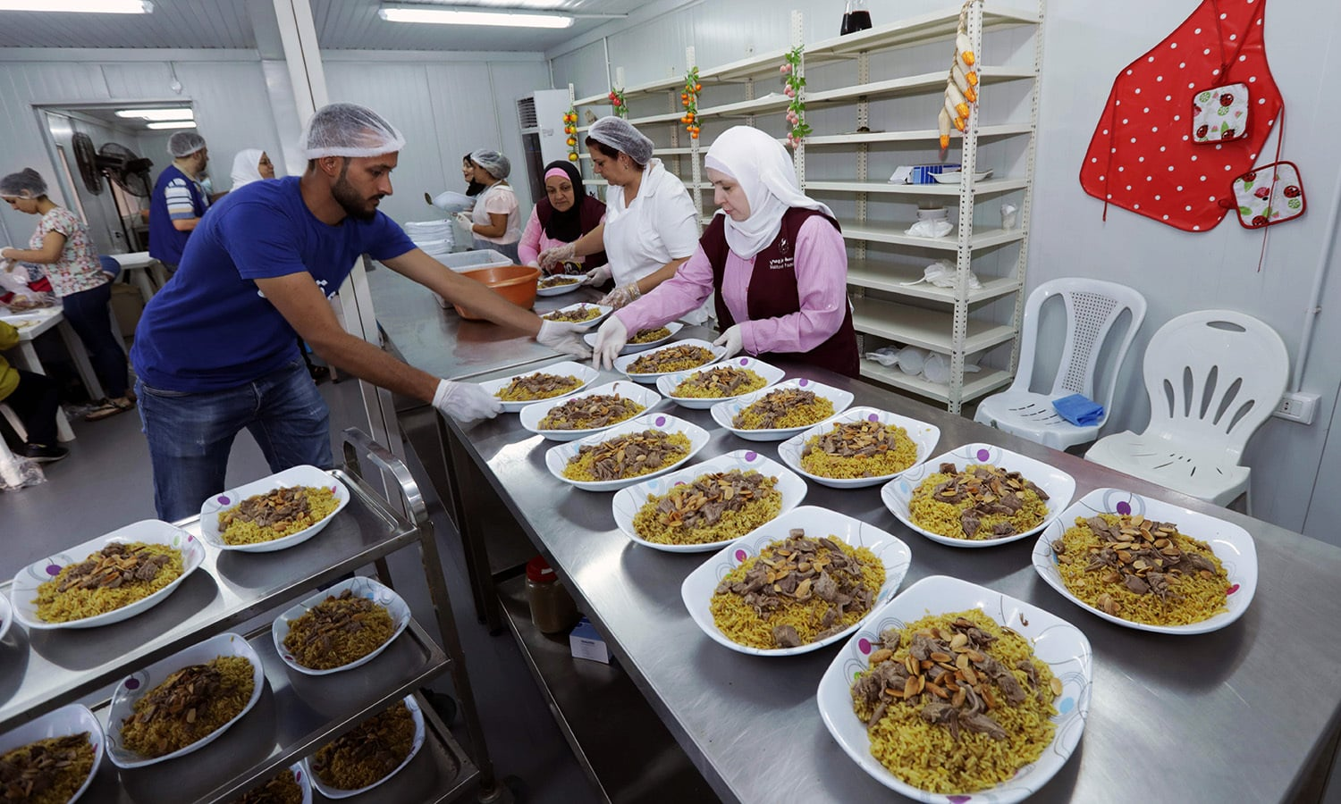 "Lebanese and Syrians prepare dishes for an ""Iftar"" dinner in the Lebanese capital Beirut on June 9.— AFP"