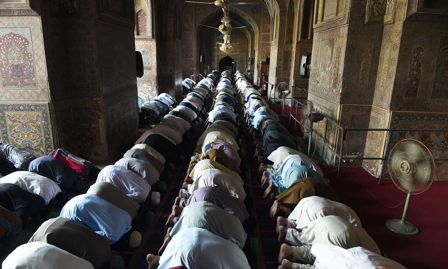 Pakistani worshippers offer prayers during the second Friday of Ramazan in Lahore on June 9.— AFP