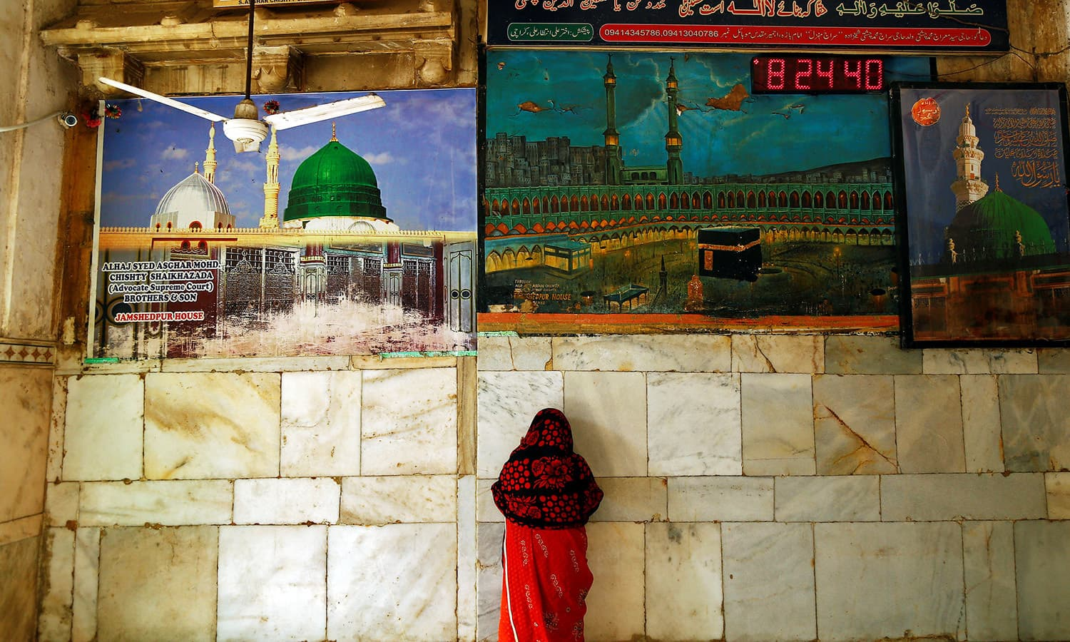 A woman offers prayers inside the shrine of Sufi saint Khwaja Moinuddin Chishti in Ajmer, India June 8.— Reuters