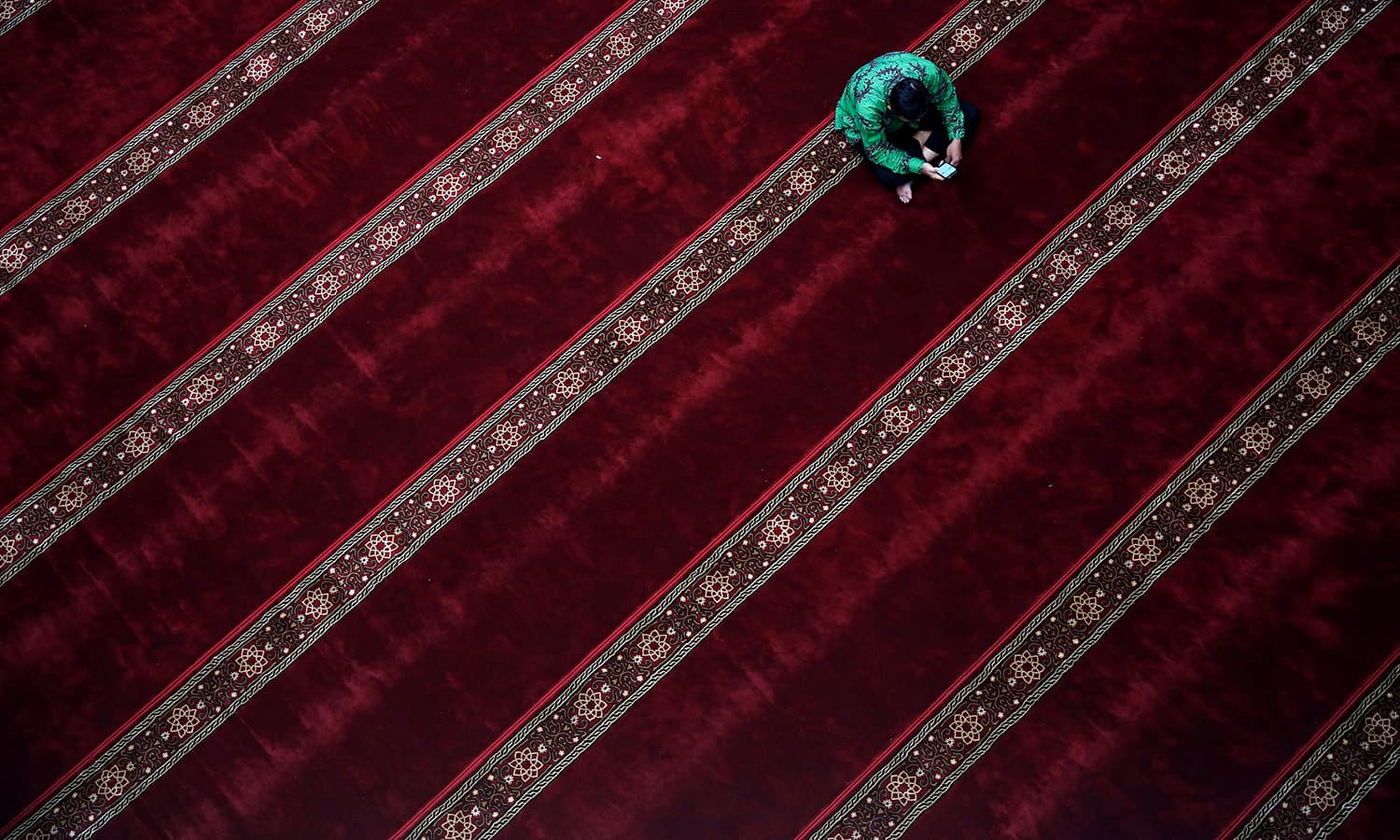 A Muslim man sits inside a mosque during Ramazan in Jakarta, Indonesia June 8.— Reuters
