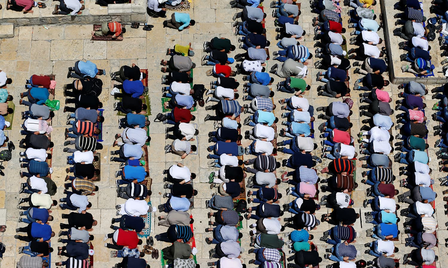 Muslims pray during the Friday prayers for Ramazan in Jerusalem's Old City June 9.— Reuters