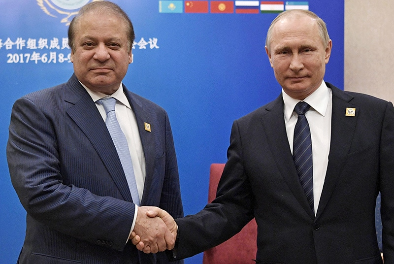 Russian President Vladimir Putin (R) shakes hands with Prime Minister Nawaz Sharif during their meeting in Astana, Kazakhstan.─AP.