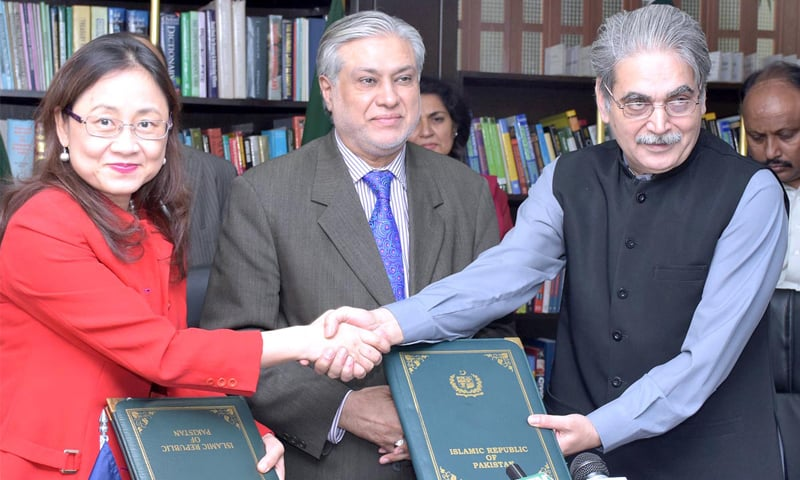 ISLAMABAD: Secretary for Economic Affairs Division Tariq Mahmood Pasha (R) and ADB Country Director for Pakistan Xiaohong Yang exchange documents after signing the loan agreement on Friday.—APP