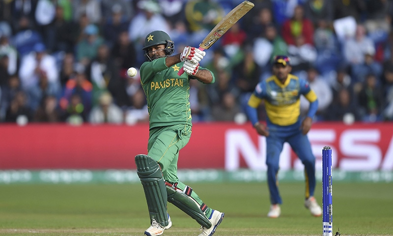 Captain Sarfraz Ahmed hits out during the match against Sri Lanka, at the Cardiff Stadium.─AP