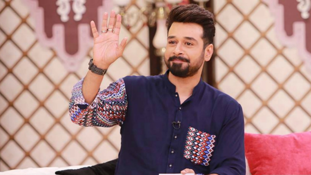 Faisal Qureshi wearing a kurta where one sleeve is printed and the other is plain.