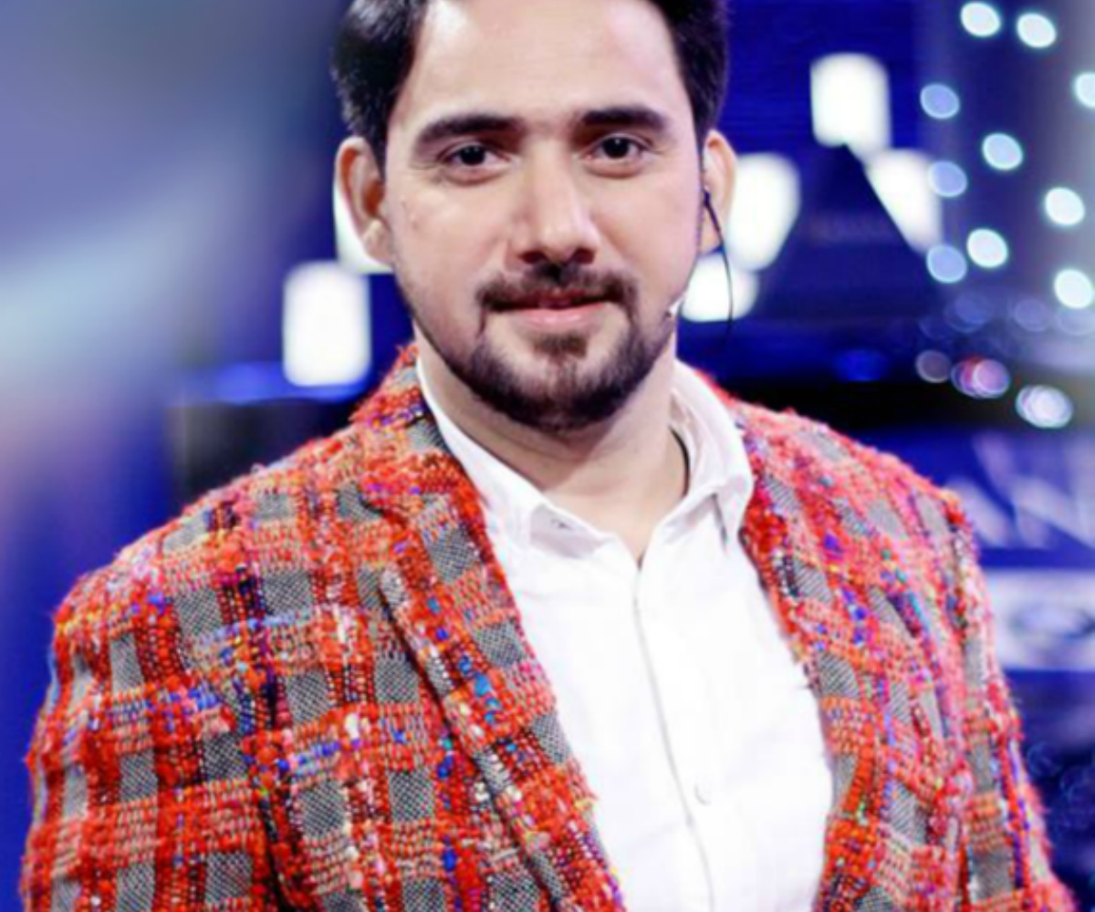 Farhan in a woolly chequered and striped jacket.