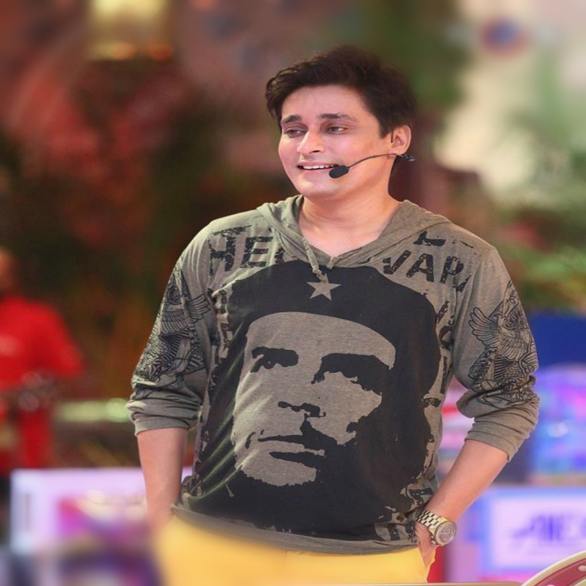 Sahir Lodhi in a a grey Che Guevara hoodie, paired with electric yellow pants.