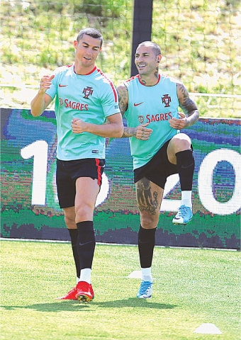 OEIRAS (Portugal): Portugal's Cristiano Ronaldo (L) and Ricardo Quaresma attend a training session ahead of the Confederations Cup on Tuesday.—Reuters