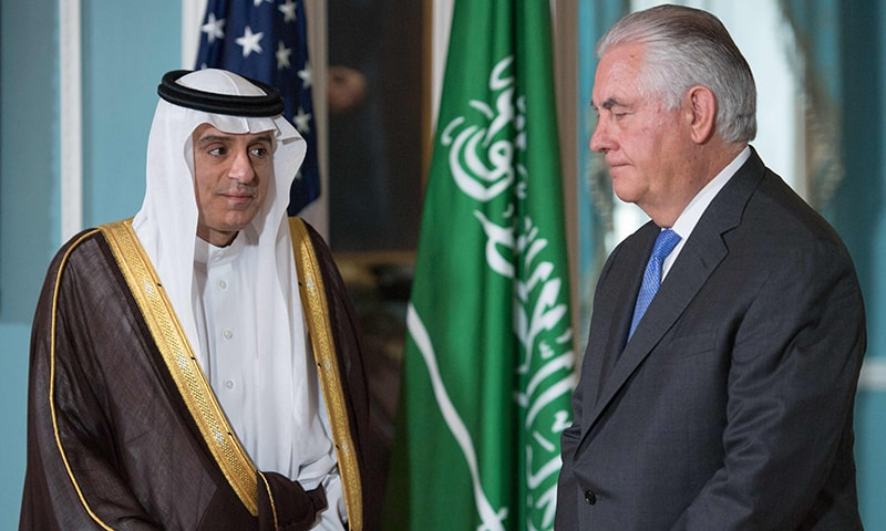 US Secretary of State Rex Tillerson and Saudi Foreign Minister Adel al-Jubeir stand before speaking to the media on June 13 shortly before their private meeting at the US Department of State in Washington.─AFP