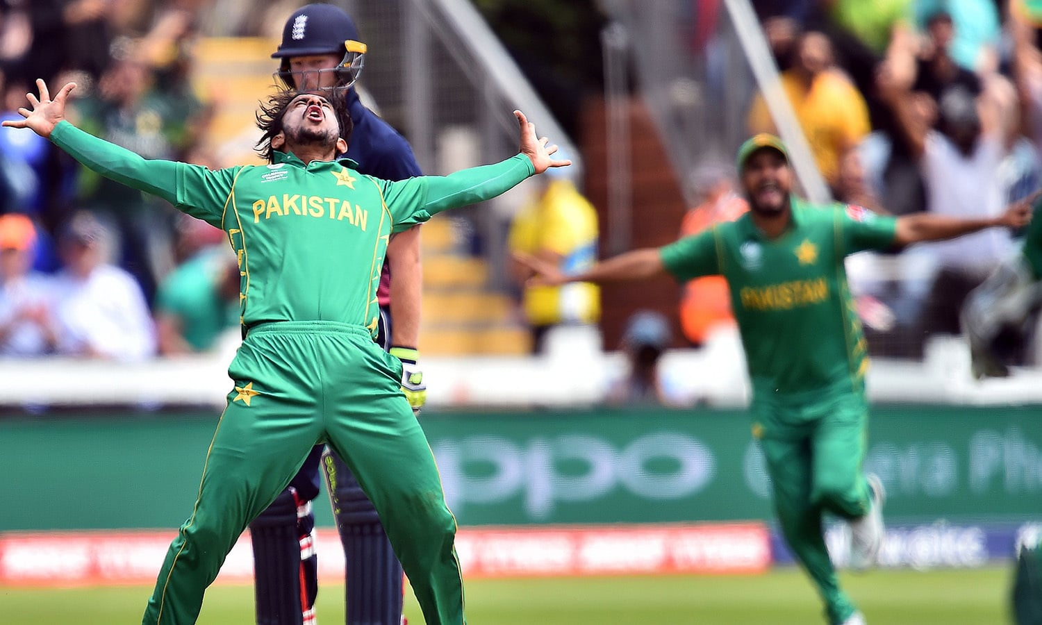Hasan Ali celebrates taking the wicket of England's Eoin Morgan for 33 runs during the semi-final match.— AFP