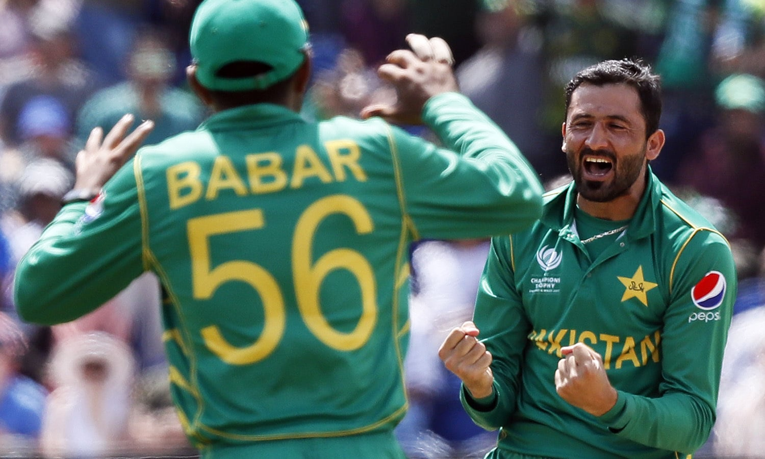 Junaid Khan, right, celebrates taking the wicket of Jos Buttler.─AP
