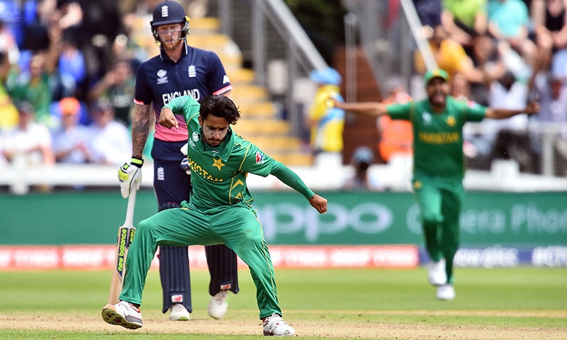 Hasan Ali celebrates taking the wicket of England's Eoin Morgan for 33 runs.— AFP