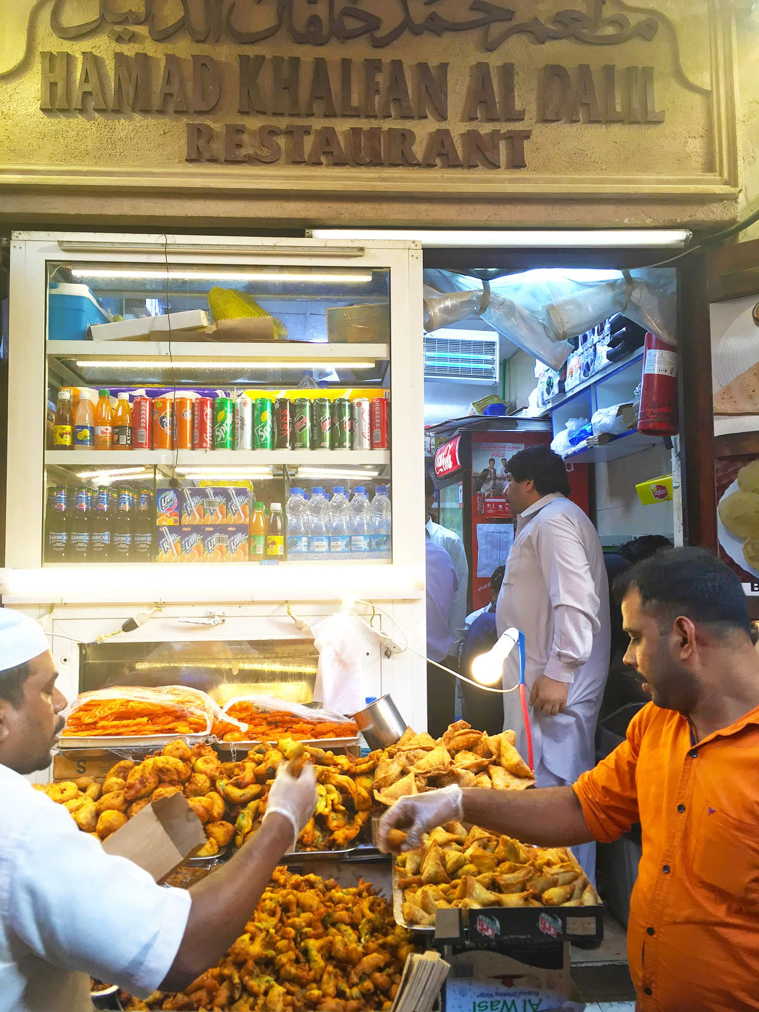 Pakistani and Indian snacks are popular among the locals as well as visitors and are easily found in the *souk*.