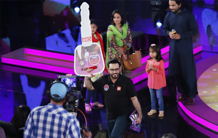 Aamir Liaquat Hussain dishes out prizes that include luxury cars and jet-planes