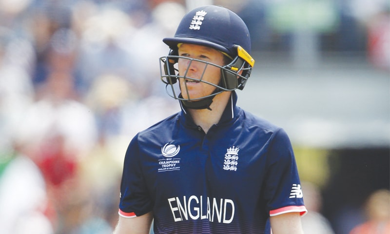 CARDIFF: England captain Eoin Morgan walks off dejected after losing his wicket in the semi-final against Pakistan.—Reuters