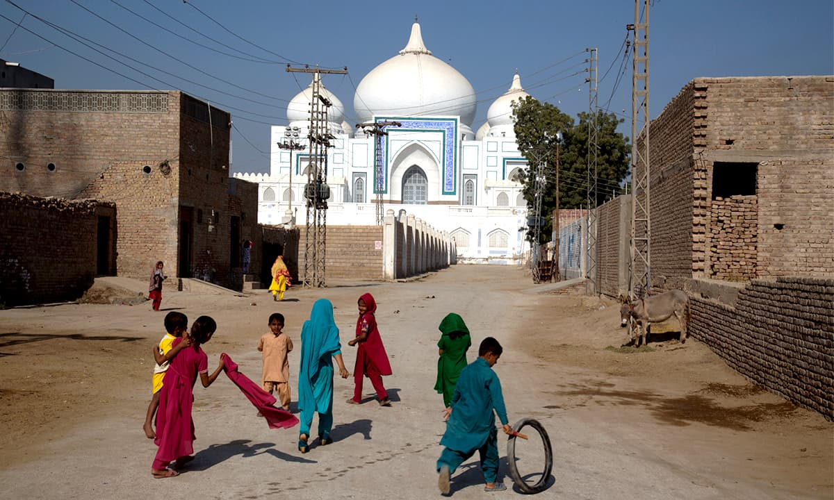 Children play in front of Zulfikar Ali Bhutto's mausoleum in Garhi Khuda Bakhsh village