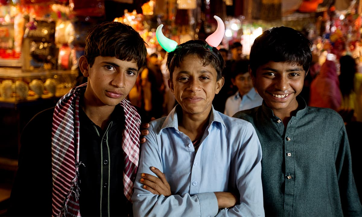 Children in the market outside the shrine of Lal Shahbaz Qalandar