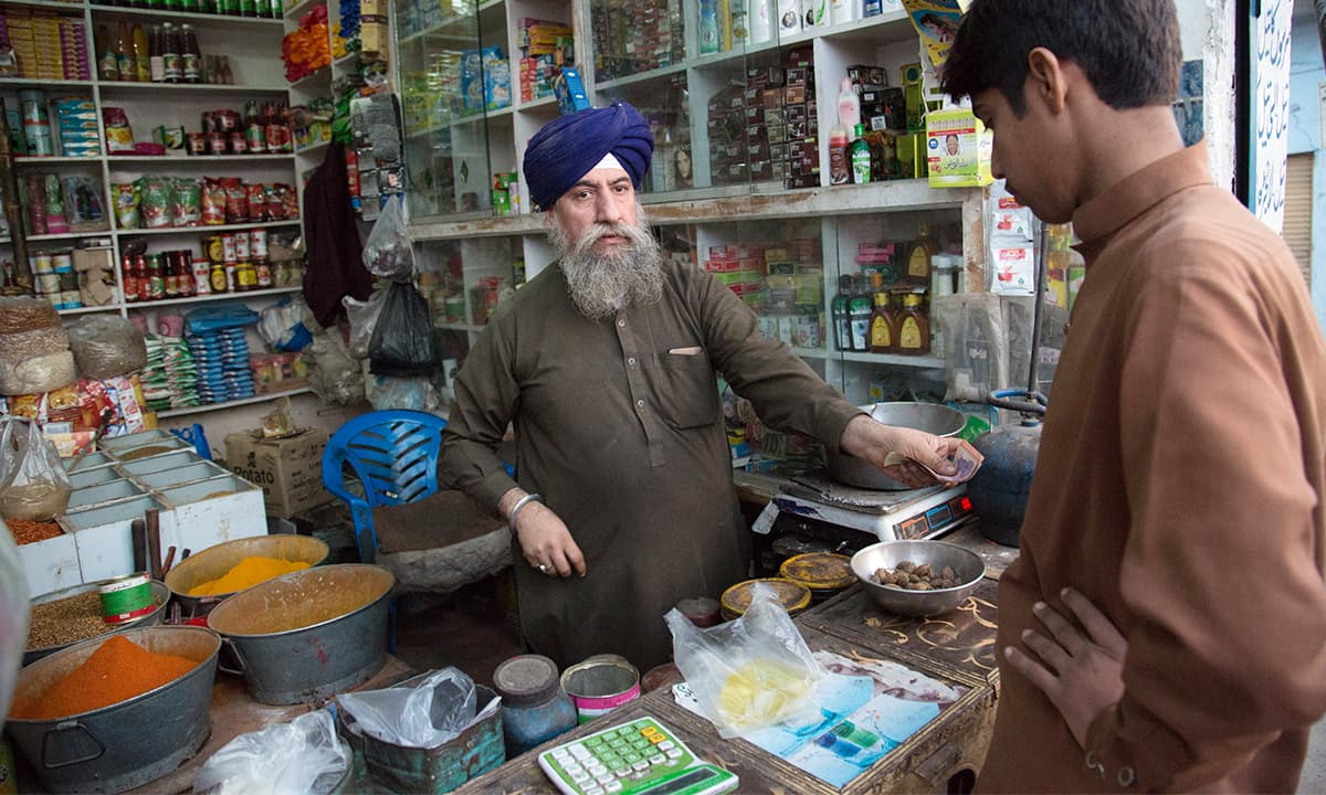 Sardar Charanjeet Singh at his grocery store on the Indus Highway just before it enters Peshawar city